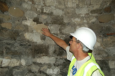 Site Manager, Gary Collings in what was the underground laboratory, shows evidence of soft Reigate Stone in the walls, and also Tudor brickwork, York Stone and Portland Stone