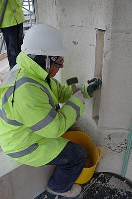 Mason preparing for new stone indent