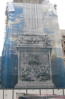 The scaffold wrap on the west elevation showing the sculpted panel by Gabriel Cibber