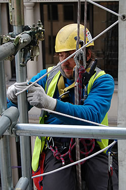 "Specialist abseilers use an elasticated ""bungee"" rope to secure and tension the wraps"