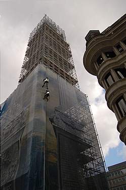 Abseilers on the south elevation make sure that the image lines up when the wraps are connected at the corners