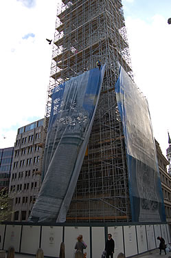 Abseilers attaching the scaffold wrap to the north elevation