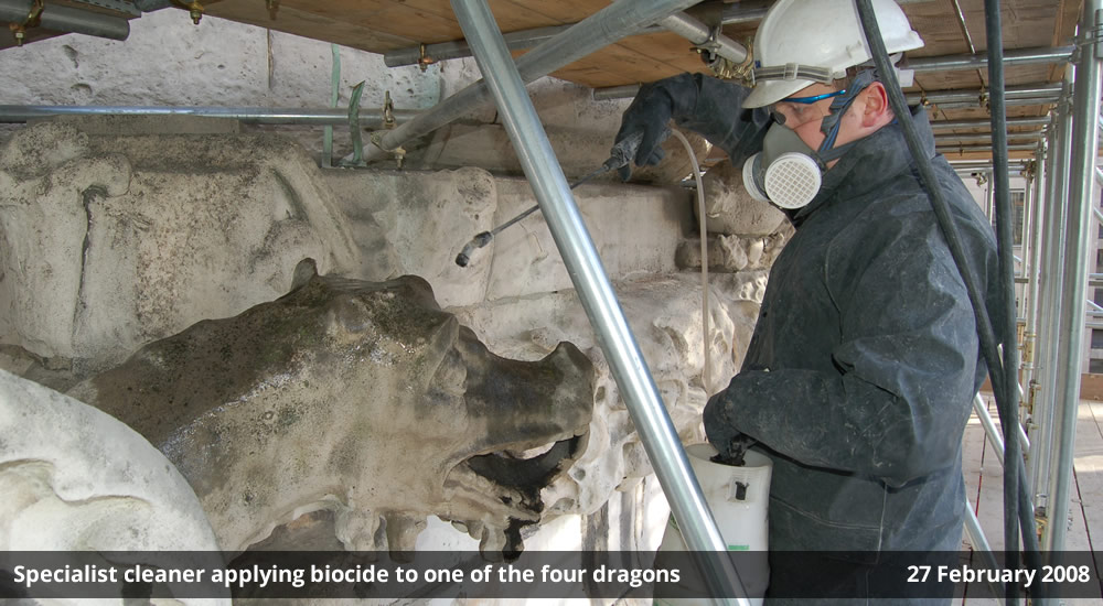 Specialist cleaner applying biocide to one of the four dragons