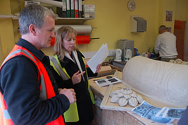 Adam Stone and Judy Allen discussing the design of the patera, with the aid of a half-size model