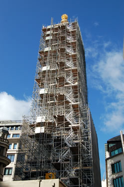 The newly gilded orb can be seen clearly now that the top of the scaffold has been removed