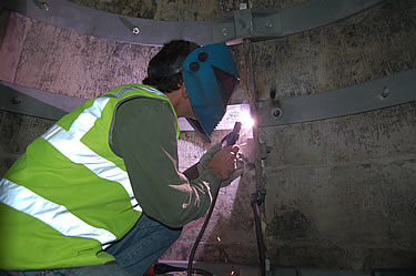 Specialists carry out high quality welding high up in the drum area.