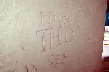 Some evidence of the historic graffiti found carved into the walls