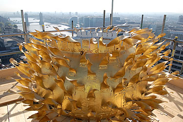 Top section of the golden orb, with Tower Bridge in the background.