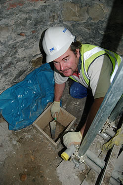 Ian Foss, carrying out an excavation in the basement